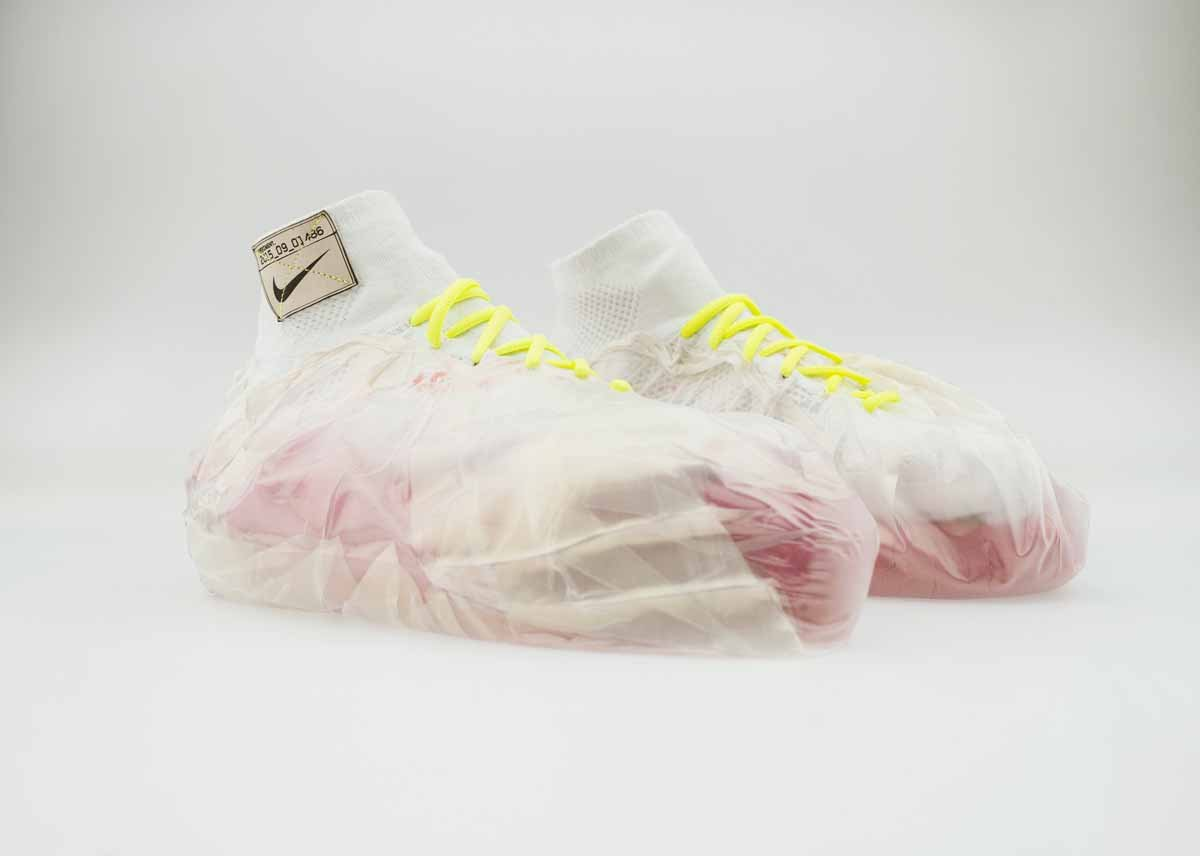 wrapped-around-these-shoes-for-impact-protection-are-plastic-bags-filled-with-kinetic-sand-for-an-adaptive-cushioning-system